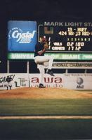 1998- pitcher winding up to throw a ball
